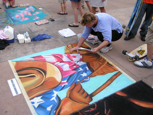 Lee Jones, Professional Street Painter, has been street painting for 20 years. Lee has traveled all over the United States, Curacao, and Italy to paint. She also teaches street painting in schools all over the country, keeping the art form alive by teaching our youth.